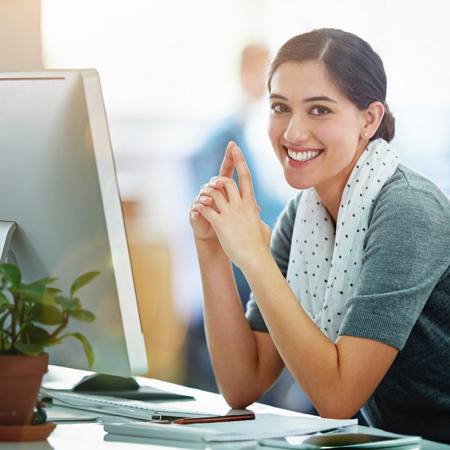 square-smiling-woman-computer